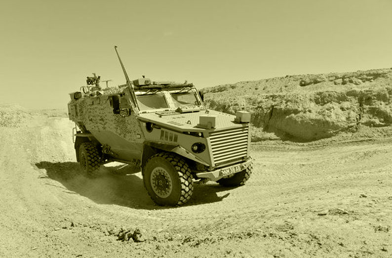 Army vehicle in desert